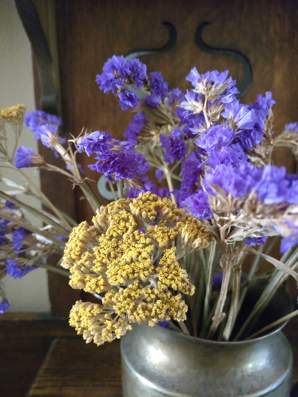 Dried-flowers-in-a-silver-pitcher