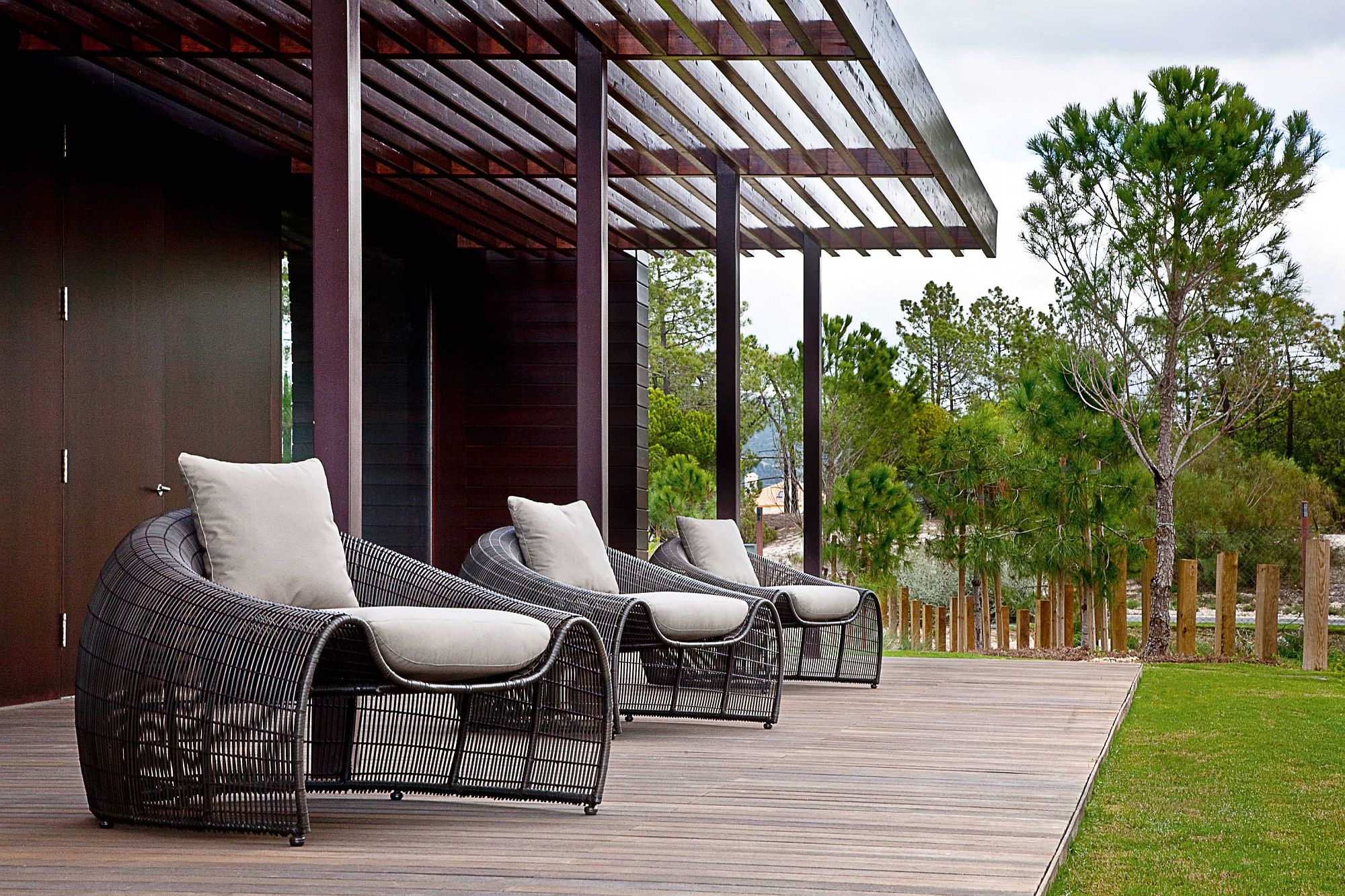 Series-of-Croissant-easy-chairs-for-the-large-wooden-deck